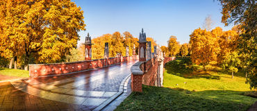 Bridge over the ravine. Bridge in the Tsaritsyno in Moscow over the ravine on a sunny autumn day Stock Photo
