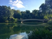 Bridge over the reflection lake in Central Park Stock Photography