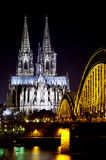 Bridge over Rhine river with Cologne Cathedral in the background at night. Cologne, Germany. Royalty Free Stock Photo