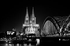 Bridge over Rhine river with Cologne Cathedral in the background at night. Cologne, Germany. Royalty Free Stock Photography