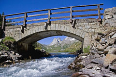 Bridge over the river. Arch bridge in the Val Ferret, near Courmayeur Royalty Free Stock Images