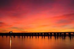 Bridge over a river. A wooden bridge over a river at sunrise Stock Photos