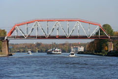 Bridge over river. The iron railway bridge over the river. Boats and barge are passing by Stock Photography