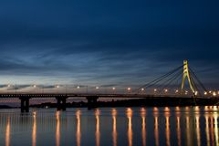 Bridge over river. Dnieper in Kiev at night stock photography