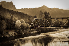 Bridge over river. Old steel bridge over a mountain river royalty free stock photography