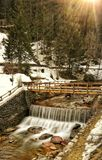 bridge over the river in the alps .. in the Trentino Italy area stock images