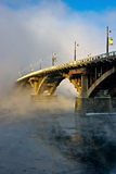 Bridge over river Angara in the fog. Irkutsk Stock Photos