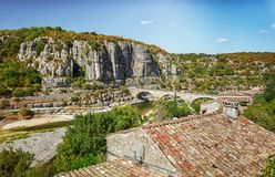 The bridge over the River Ardeche near the old village Balazuc i. The bridge over the river Ardeche near the old village Balazuc which village is recognized as stock photo