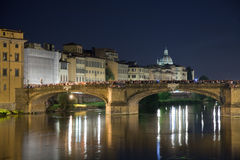 Bridge over river arno. A crowd gathered on a bridge over the River Arno in Florence, Italy, at night Royalty Free Stock Image