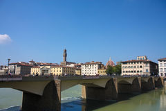 Bridge over the River Arno, Florence. In the distance, Tower of Arnolfo's Palazzo Vecchio. World Heritage Site Royalty Free Stock Images