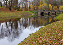 Bridge over a river in autumn park Stock Photography