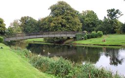 Bridge over River Avon at the garden of Warwick Castle in England Stock Photo