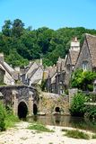 Bridge over the river Bybrook, Castle Combe. Stone bridge over the river Bybrook with cottages to the rear, Castle Combe, Wiltshire, England, UK, Western Europe Stock Image