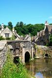 Bridge over the river Bybrook, Castle Combe. Stone bridge over the river Bybrook with cottages to the rear, Castle Combe, Wiltshire, England, UK, Western Europe Stock Photos