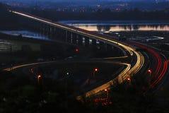 Headlights. Bridge over the river and car headlights Stock Photos