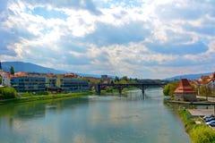 Bridge over river Drava in Maribor. Historical red bridge Glavni most in Maribor city in Slovenia royalty free stock photo