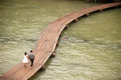 Daily on the bridge over the river. Fenghuang, China – June 9 : Daily life of villager on wooden bridge in the old town on June 9, 2015 in Fenghuang city Stock Photos