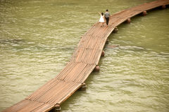 Daily on the bridge over the river. Fenghuang, China – June 9 : Daily life of villager on wooden bridge in the old town on June 9, 2015 in Fenghuang city Royalty Free Stock Images