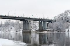 The bridge over the river and the forests is frozen stock images