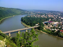 Bridge over river from height aerial view. View of beautiful river bend  around town Royalty Free Stock Photo
