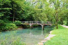 Bridge over a river in the Jura, France royalty free stock images