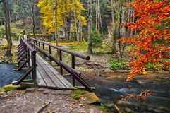 Bridge over river Kamenice during autumn royalty free stock image