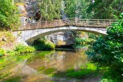 Bridge over river Kamenice in Bohemian Switzerland National Park, Czech Republic.  stock photos