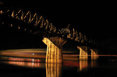 Bridge over River Kwai. Bridge over the river kwai at night. The bridge is located in Kanchanaburi, Thailand. It is famous for being bombed in the 2nd world war Royalty Free Stock Image