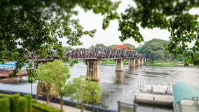 Bridge over the River Kwai. Old bridge over the River Kwai on tilt shift is a historical attractions during World War 2 the famous of Kanchanaburi Province in Stock Images