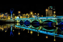 Bridge over River Lagan in Belfast. A colorful arched bridge reflecting in the River Lagan at night, Belfast, Northern Ireland Stock Photography