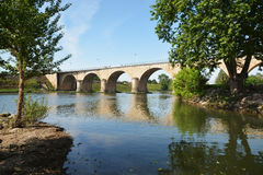 Bridge over the river Le Lot in France. The bridge at Aiguillon over the river Le Lot in Southern France Royalty Free Stock Photography