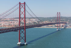 Bridge over river, Lisboa. Red Bridge, Bridge April 25 Lisbon over river Royalty Free Stock Images
