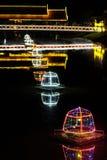 Bridge over the river lit by night lights, illumination.  royalty free stock image