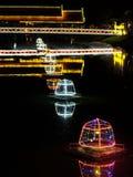Bridge over the river lit by night lights, illumination.  stock photos