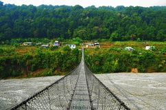 Bridge over the river in Nepal. River Bridge. royalty free stock photography