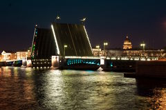 Bridge over river at night. Palace bridge over Niva river at night in St. Petersburg, Russia Stock Photos