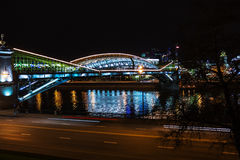 Bridge over the river at night Moscow. View of Moscow. Pedestrian Bogdan Khmelnitsky Bridge was built in 1907 and reconstruction in 2001 Royalty Free Stock Photos