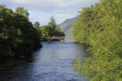 Bridge over River Oich with fort Augustus, Loch Ness in Scotland. United Kingdom stock image