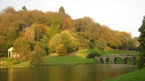 Bridge over river scene in Autumn or the fall season Stock Photo