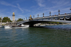 The Bridge over the River Seine - Alexandre III Bridge in Paris, France - and tour boat, August 1, 2015 Royalty Free Stock Image
