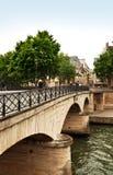 Bridge Over The River Seine, P. Bridge between the left bank and Ile de la Cite spanning the River Seine in Paris Stock Image