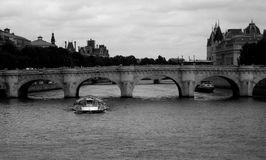 Tour boats under River Seine bridge Royalty Free Stock Images