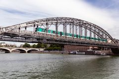 Bridge over river Seine in Paris with subway passing Stock Photos