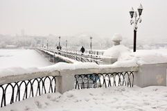 Bridge over the river in the snow. Pedestrian bridge over the frozen river, snow Royalty Free Stock Photo