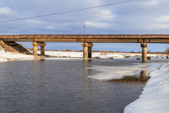 Bridge over the river in the spring. Just got off the ice, sunny day Royalty Free Stock Photos