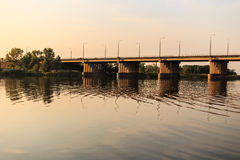 Bridge over the river. At sunset Royalty Free Stock Photography
