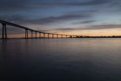 Bridge over river at sunset Royalty Free Stock Photography