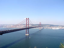 Bridge over river tagus. Bridge 25 Abril, over river tagus - Tejo - with view over Lisbon - Portugal Royalty Free Stock Images
