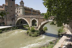 A Bridge over the River Tiber Rome Italy. Ponte Fabbrichio an ancient Bridge over the River Tiber Rome Italy Stock Photography