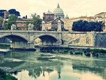 Bridge over river tiber in rome. Italy and st. peter's basilica in the background Stock Photography